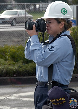 Photographer - A U.S. Navy photographer in March 2004.