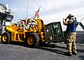 US Navy 040328-N-8053S-081 A Marine assigned to 22nd Marine Expeditionary Unit (22nd MEU) Special Operations Capable (SOC) moves equipment onto a Landing Craft Utility (LCU) using a forklift.jpg