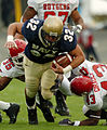 US Navy 041120-N-9693M-004 U.S. Naval Academy Midshipman 1st Class Kyle Eckel breaks through a line of Rutgers University defenders for yardage.jpg