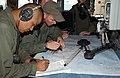 US Navy 050402-N-5526M-007 Quartermaster 2nd Class Bradley Stevens and Quartermaster 2nd Class Johnny Garcia plot a course as the Cyclone-class patrol coastal boat USS Chinook (PC 9) transits the Persian Gulf.jpg