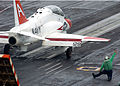 US Navy 050624-N-0535P-068 A T-45A Goshawk trainer aircraft assigned to Training Air Wing One prepares to launch from a steam-powered bow catapult on the flight deck aboard the Nimitz-class aircraft carrier.jpg