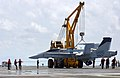 US Navy 050802-N-5345W-039 Crash and Salvage division personnel stabilize a training airframe as it is removed from the landing area by the emergency heavy lift crane Tilly.jpg