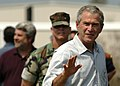 US Navy 050912-N-6925C-006 President George W. Bush waves to U.S. Navy Seabees, assigned to Naval Mobile Construction Battalion One (NMCB-1), during his recent visit to the 28 Street Elementary School in Biloxi, Miss.jpg