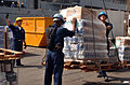 US Navy 051019-N-9563N-014 U.S. Navy Sailors assigned to the amphibious transport dock USS Cleveland (LPD 7), load pallets of flour, milk and bread bound for earthquake victims in Pakistan.jpg