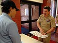 US Navy 060518-N-0962S-072 Master Chief Petty Officer of the Navy (MCPON) Terry Scott quizzes a student standing quarterdeck watch on Navy officer and enlisted pay grades.jpg