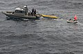 US Navy 060526-N-9851B-002 Sailors aboard a Rigid Hull Inflatable Boat (RHIB) assigned to the amphibious dock landing ship USS Tortuga (LSD 46) prepare to attach a yellow target to a Ship Deployed Surface Target (SDST).jpg