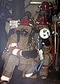 US Navy 061019-N-0730W-013 Members of the at-sea fire party, Damage Controlman 2nd Class Darren Falcon, Damage Controlman 2nd Class Jeremiah McCullough, and Damage Controlman 3rd Class Dennis Cherry train to fight a fire.jpg