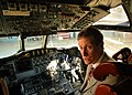 US Navy 061026-N-4515N-172 A guest at the vintage awards ceremony to honor the coast guardsmen that rescued Navy Sailors from a crash sits in the cockpit of a P-3 Orion.jpg