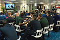 US Navy 061106-N-4207M-001 Sailors on board amphibious assault ship USS Essex (LHD 2) participate in the annual pre-holiday safety stand down by watching a video on driving safety.jpg