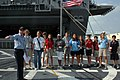 US Navy 070501-N-4014G-138 Operations Specialist 1st Class Justin Frederick guides students from Ransom Everglades Middle School in a tour aboard guided missile destroyer USS Forrest Sherman (DDG 98).jpg