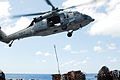 US Navy 070524-N-1831S-100 An MH-60S Seahawk, assigned to Helicopter Sea Combat (HSC) 22, drops supplies aboard amphibious assault ship USS Kearsarge (LHD 3).jpg