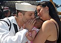 US Navy 070827-N-4007G-004 A Sailor greets his newborn child for the first time at Naval Air Station North Island after concluding a 7.5-month deployment aboard USS John C. Stennis (CVN 74).jpg