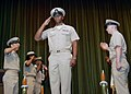 US Navy 070920-N-6295H-002 Newly pinned Chief Electrician's Mate Elroy Serano salutes as fellow chief petty officers render honors during a pinning ceremony.jpg
