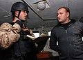 US Navy 080722-N-9703H-057 Ensign Kevin Brandwein questions ship's Master Senior Lt. Andre Konshin.jpg
