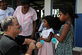 US Navy 080817-N-7955L-054 U.S. Public Health Service Cmdr. Dale Bates, embarked aboard the amphibious assault ship USS Kearsarge (LHD 3), discusses the proper use of fluoride with a family in at the Betania medical clinic.jpg
