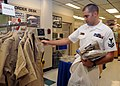 US Navy 081115-N-9758L-006 Yeoman 2nd Class Richard Moseley shops for the new service uniform at the Navy Exchange Uniform Shop.jpg