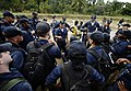 US Navy 100125-N-5345W-429 Lt. Joel Castillo, assigned to the multi-purpose amphibious assault ship USS Bataan (LHD 5) talks to Sailors after they completed the community relief project at the Lifeline Christian Ministries Miss.jpg
