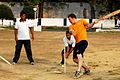 US Navy 100323-N-8335D-590 Mineman 3rd Class John Parker, assigned to the mine countermeasures ship USS Patriot (MCM 7), is taught how to play cricket by Indian navy physical training instructors.jpg