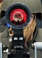 US Navy 101112-N-2218S-015 unner's Mate 2nd Class Anthony Chenoweth looks through the sight of a Mk-38 25 mm gun during a training exercise aboard.jpg