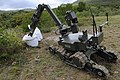 US Navy 101116-N-8546L-850 Uruguayan explosive ordnance disposal technicians remotely operate an ANDROS robot to examine a secondary improvised exp.jpg