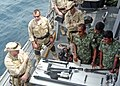 US Navy 101121-N-1225M-088 Members of the guided-missile destroyer USS Momsen's (DDG 92) visit, board, search and seizure (VBSS) team, discuss the.jpg