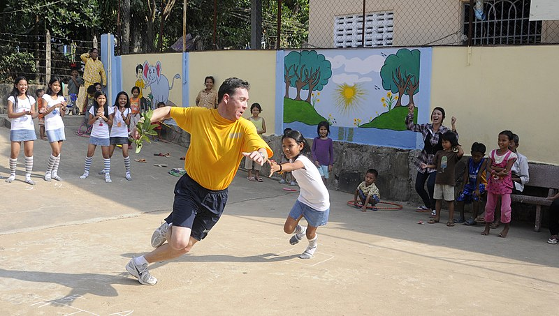 File:US Navy 110301-N-4920H-107 Chief Operations Specialist Steven Rowlands avoids a tag during a game of nap lungdy during a community service event at.jpg