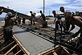 US Navy 110315-N-1825E-252 Seabees assigned to Naval Mobile Construction Battalion (NMCB) 28 lay concrete during the construction of a recreation c.jpg