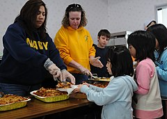 US Navy 110327-N-MU720-031 Volunteers erve food to children at the Biko-en Children's Care House