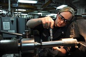 Shear pin - A sailor checks the outside diameter of a shear pin in the machinery repair shop aboard US aircraft carrier ''John C. Stennis''