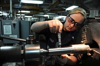 Shear pin - A sailor checks the outside diameter of a shear pin in the machinery repair shop aboard US aircraft carrier John C. Stennis