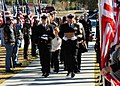 US Navy 111117-N-SN160-125 Service members and civilians pay their respects as Chief Builder Raymond Border's remains are carried to a memorial ser.jpg