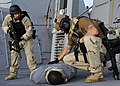 US Navy 120114-N-VH839-086 Senior Chief Damage Controlman Jared Klink and a U.S. Coast Guardsman apprehend a suspected pirate aboard the Arleigh Bu.jpg