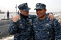 US Navy 120208-N-NK458-007 Master Chief Petty Officer of the Navy (MCPON) Rick D. West speaks with Logistics Specialist 3rd Class David Terrones, f.jpg