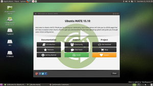Ubuntu MATE 15.10 welcome screen on laptop.png