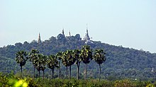 Mountain covered with jungle, and ancient pagodas