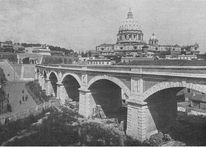 Rail transport in Vatican City - Eight-span viaduct carrying the Vatican Railway over the Gelsomino valley up to the sliding-door gateway into Vatican precincts. St. Peter's in the background. Railway Magazine (1934)