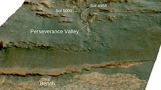 View looking west on to Perseverance Valley on the western rim of Endeavour crater laid over 3-D topographic map of the terrain with 5-fold vertical exaggeration.jpg
