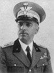 a standing male in Italian uniform with peaked cap