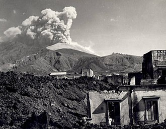 San Sebastiano al Vesuvio - Volcanic eruption of Vesuvius in March 1944. In the foreground is the village of San Sebastiano al Vesuvio. The lava flow (in the left foreground) flowed through the village on the day before this photo was taken.