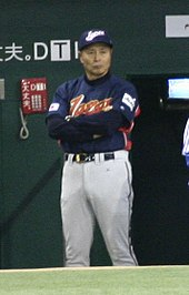 Sadaharu Oh standing wearing a Japan national baseball team uniform during the 2006 Wold Baseball Classic