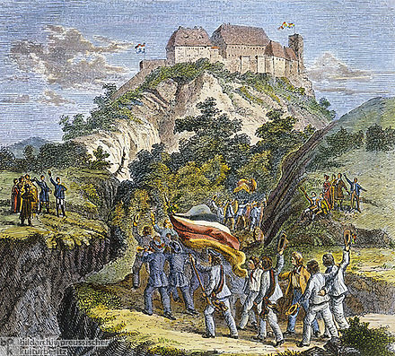 In October, 1817, approximately 500 students rallied at Wartburg Castle, where Martin Luther had sought refuge over three centuries earlier, to demonstrate in favor of national unification. Wartburg was chosen for its symbolic connection to German national character. Contemporary colored wood engraving[15]