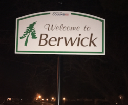 "Looking at the community's ""Welcome to Berwick"" sign near the intersection of S. James Rd and Scottwood Rd"