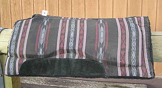 Saddle blanket - A modern western saddle pad, with blanket design on top, fleece underneath, and felt or foam padding on the inside