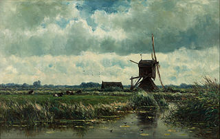 Paysage de polder avec moulin à vent près d'Abcoude