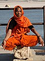 Woman Meditating by Ganges (Ganga) River - Varanasi - Uttar Pradesh - India (12480116833).jpg