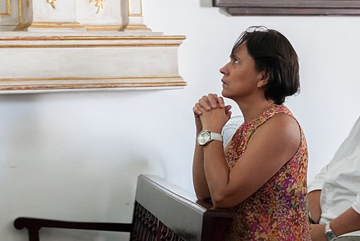Woman praying in Cristo buen Viaje Church