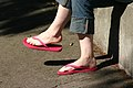 Woman wearing red flip flops.jpg
