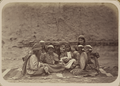 Women's Customs among the Tajiks. Group of Young Women, Sitting Together with Their Arms around Each Other and Their Eyes Closed. One Woman Holds a Drum WDL11183.png