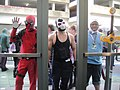 WonderCon 2012 - Deadpool, Bane, and Finn from Adventure Time through glass (6873354644).jpg