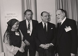 Raymond Barre - Raymond Barre standing next to Mother Tessa Bielecki and Rabbi Immanuel Jakobovits during the 1989 World Economic Forum